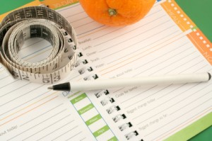 Journal With Orange and Measuring Tape