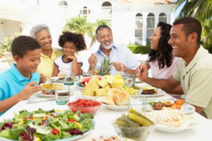 Family Smiling While Eating