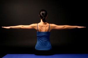 Woman with Arms Extended in Pilates Stretch