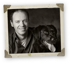 Black Dog with Smiling Man