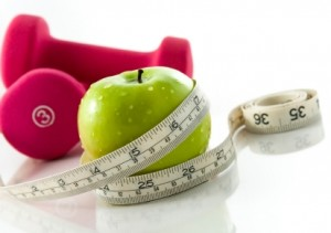 Measuring Tape with Weights and Apple